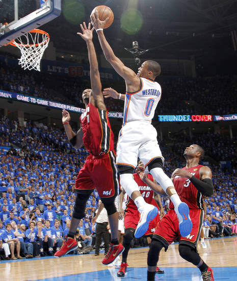 Oklahoma City's Russell Westbrook (0) goes past Miami's Chris Bosh (1) during Game 1 of the NBA Finals between the Oklahoma City Thunder and the Miami Heat at Chesapeake Energy Arena in Oklahoma City, Tuesday, June 12, 2012. Photo by Chris Landsberger, The Oklahoman