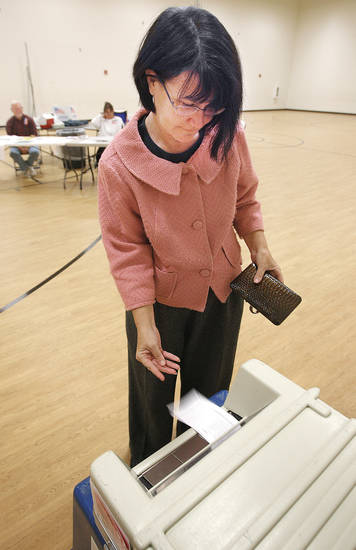 Lynda Barnes votes Tuesday at Deer Creek Middle School.  PHOTO BY  DAVID MCDANIEL, THE OKLAHOMAN