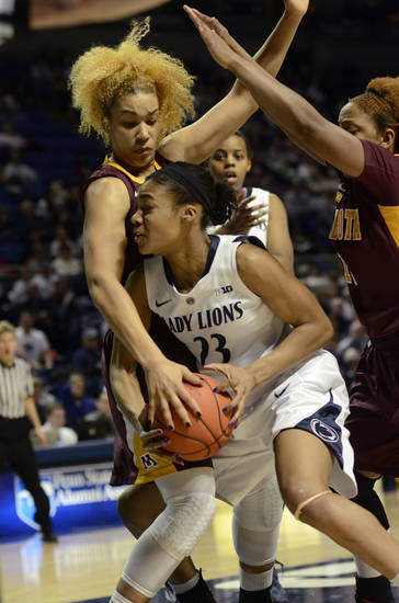 Penn State's Ariel Edwards (23) looks for shot past Minnesota's Micaella Riche, left, and Leah Cotton during the first half of an NCAA college basketball game in State College, Pa., Thursday, Jan. 24, 2013. (AP Photo/Ralph Wilson)