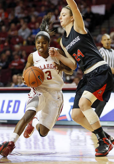 Oklahoma's Aaryn Ellenberg (3) drives against Cal State Northridge's Marta Masoni (24) in the second half during a women's college basketball game between the University of Oklahoma (OU) and Cal State Northridge at the Lloyd Noble Center in Norman, Okla., Saturday, Dec. 29, 2012. OU won, 79-57.  Photo by Nate Billings, The Oklahoman