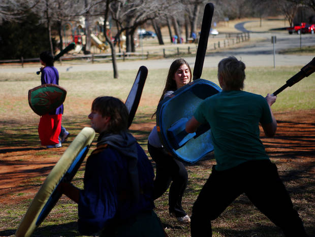 Carmen Chilson, right practices Dagorhir at Hafer Park in Edmond, Okla., Saturday, Feb. 16, 2013. A group of Dagorhir players meet every Saturday in Hafer park to practice the game that involves battling with foam weapons. Photo by Bryan Terry, The Oklahoman