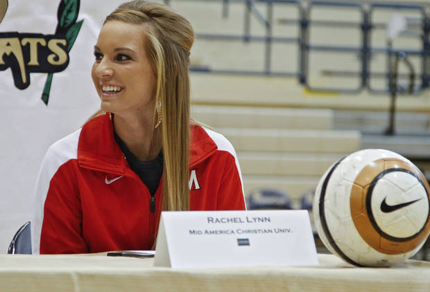 Southmoore High School's Rachel Lynn sits at a table after signing her letter of intent to play soccer at Mid-America Christian University  during National Signing Day at Southmoore High School on Wednesday, Feb. 1, 2012, in Oklahoma City, Okla. Photo by Chris Landsberger, The Oklahoman