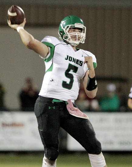 Jones' David Cornwell throws in high school football as Tuttle plays Jones on Friday, Oct. 19, 2012 in Tuttle, Okla.  Photo by Steve Sisney, The Oklahoman