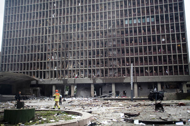 Debris covers the area outside a building in the centre of Oslo, Friday July 22, 2011, following an explosion that tore open several buildings including the prime minister's office, shattering windows and covering the street with documents.(AP Photo/Fartein Rudjord)
