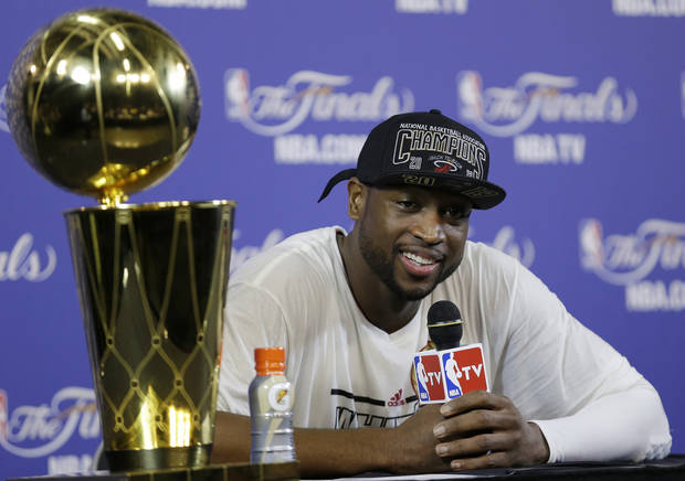 The Miami Heat's Dwyane Wade speaks during the post game news conference following Game 7 of the NBA basketball championship game San Antonio Spurs, Friday, June 21, 2013, in Miami. The Miami Heat defeated the San Antonio Spurs 95-88 to win their second straight NBA championship. (AP Photo/Lynne Sladky)