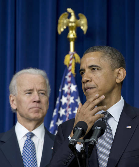 President Barack Obama, accompanied by Vice President Joe Biden, pauses as he talked about proposals to reduce gun violence, Wednesday, Jan. 16, 2013, in the South Court Auditorium at the White House in Washington. (AP Photo/Carolyn Kaster) ORG XMIT: DCCK102