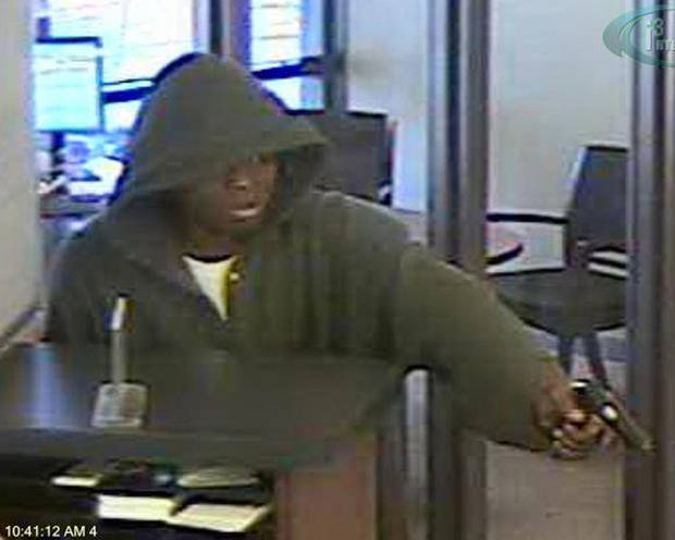 A robber is caught on camera at a Bank of Oklahoma branch, 2601 N Meridian, in Oklahoma City.