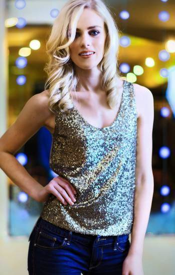 Model Emily wears an Elie Tahari sequin tank, from CK & Co. Makeup by Lilly Stone, Sooo Lilly Cosmetics. Photo by Chris Landsberger, The Oklahoman