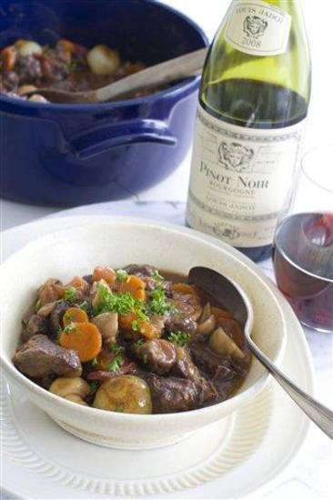 In this image taken on April 23, 2012, Julia Child's beef bourguignon recipe is paired with a pinot noir as seen in Concord, NH. (AP Photo/Matthew Mead)