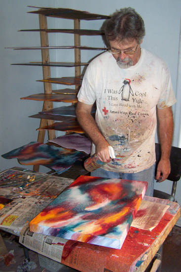 Tulsa mixed-media artist Neil Cluck is the featured painter for this year's Arts Festival Oklahoma at Oklahoma City Community College, so his work is featured on the 2012 event poster. Photo provided. <strong></strong>