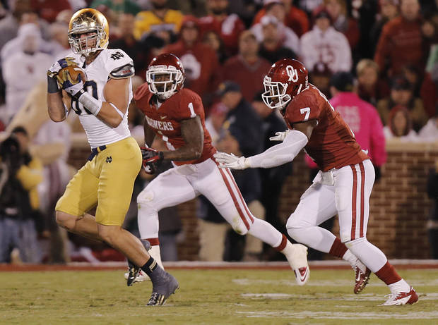 Notre Dame 's Tyler Eifert (80) makes a catch in front of OU's Tony Jefferson (1) and Corey Nelson (7) during the college football game between the University of Oklahoma Sooners (OU) and the Notre Dame Fighting Irish at the Gaylord Family-Oklahoma Memorial Stadium on Saturday, Oct. 27, 2012, in Norman, Okla. Photo by Chris Landsberger, The Oklahoman