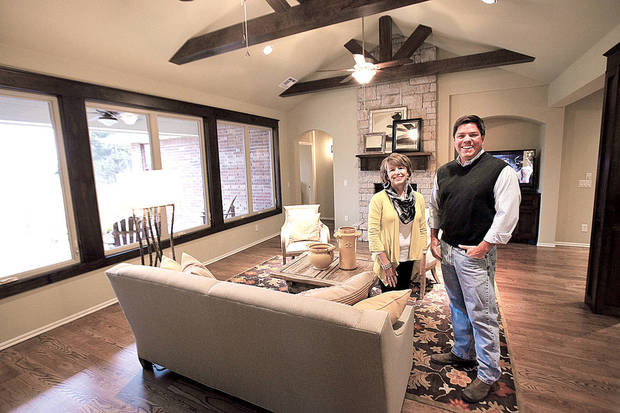 Homebuilder-developer Caleb McCaleb and his wife, interior decorator Terri McCaleb, show the living area of an Arts & Crafts bungalow that is a McCaleb Homes model at 732 Road Not Taken in Edmond. <strong>David McDaniel - The Oklahoman</strong>
