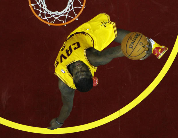 Cleveland Cavaliers' Dion Waiters sails in for a dunk against the Atlanta Hawks in the first quarter of an NBA basketball game, Friday, Dec. 28, 2012, in Cleveland. (AP Photo/Mark Duncan)