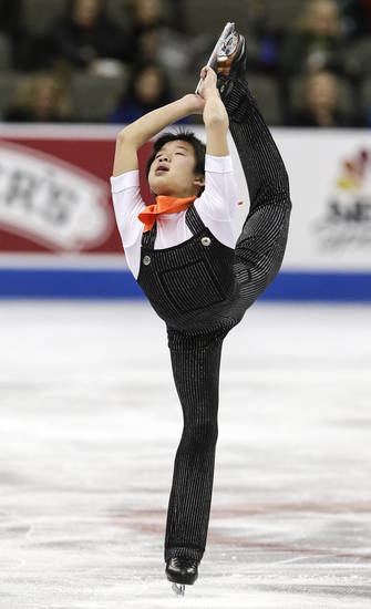 Tomoki Hiwatashi competes in the novice men's short program at the 2013 U.S. Figure Skating Championships in Omaha, Neb., Sunday, Jan. 20, 2013. (AP Photo/Nati Harnik)