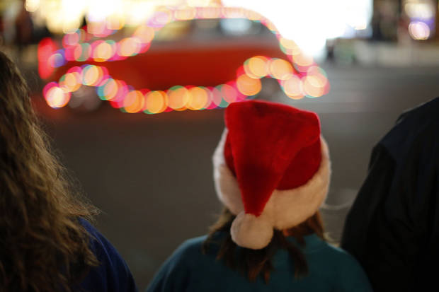 Below: People watch a lighted car during a Christmas parade in El Reno.