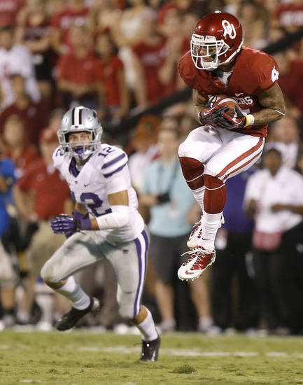 Oklahoma's Kenny Stills (4) makes a catch in front of Kansas State's Ty Zimmerman (12) during a college football game between the University of Oklahoma Sooners (OU) and the Kansas State University Wildcats (KSU) at Gaylord Family-Oklahoma Memorial Stadium, Saturday, September 22, 2012. Photo by Bryan Terry, The Oklahoman