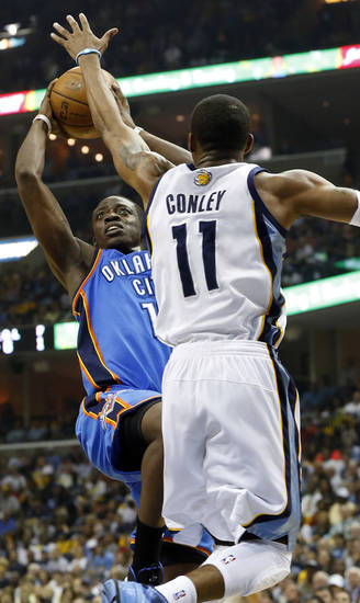 Oklahoma City's Reggie Jackson (15) shoots against Memphis' Mike Conley (11) during Game 3 in the second round of the NBA basketball playoffs between the Oklahoma City Thunder and Memphis Grizzles at the FedExForum in Memphis, Tenn.,  Saturday, May 11, 2013. Photo by Nate Billings, The Oklahoman