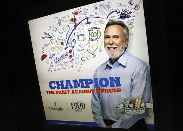 The Regional Food Bank of Oklahoma is one of six nonprofit agencies to be featured in Chesapeake Energy Corp.'s Cheering for Champions campaign, which includes advertisements like this sign at Chesapeake Energy Arena. <strong>PAUL B. SOUTHERLAND - The Oklahoman</strong>