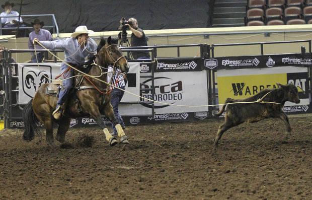 Ryle Smith, of Oakdale, Calif., competes in tie-down roping during the Ram National Circuit Finals Rodeo Championship in Oklahoma City, Sunday, April 1, 2012.  Photo by Garett Fisbeck, For The Oklahoman