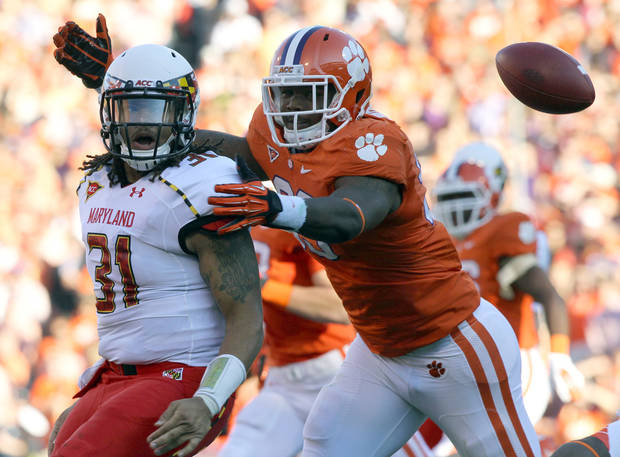 Maryland quarterback Shawn Petty loses the football in front of Clemson defensive tackle Corey Crawford during the first quarter of an NCAA college football game, Saturday, Nov. 10, 2012, in Clemson, S.C. Crawford recovered the ball to score a touchdown. (AP Photo /Anderson Independent Mail, Ken Ruinard) THE GREENVILLE NEWS OUT, SENECA NEWS OUT