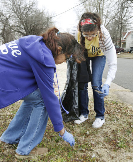 Mayra Torres, left, and Cheyenne Santos pick up trash during the UCO Big Event Day near SW 5 and Dewey in Oklahoma City.  By Paul Hellstern, The Oklahoman <strong>PAUL HELLSTERN - Oklahoman</strong>
