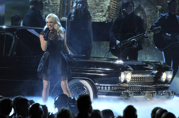 "Carrie Underwood performs ""Two Black Cadillacs"" at the 48th Annual Academy of Country Music Awards at the MGM Grand Garden Arena in Las Vegas on Sunday, April 7, 2013. (Photo by Chris Pizzello/Invision/AP) ORG XMIT: NVPM256"