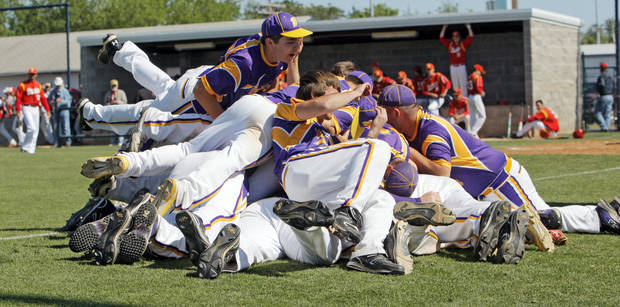 The Wister Wildcats celebrate after winning the Class 2A high school baseball championship game against Dale in Shawnee, Okla., Saturday, May 14, 2011. Wister won, 4-2. Photo by Nate Billings, The Oklahoman