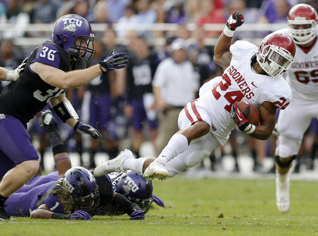 Oklahoma's Brennan Clay (24) runs past TCU's Joel Hasley (36) during a college football game between the University of Oklahoma Sooners (OU) and the Texas Christian University Horned Frogs (TCU) at Amon G. Carter Stadium in Fort Worth, Texas, Saturday, Dec. 1, 2012. Photo by Bryan Terry, The Oklahoman