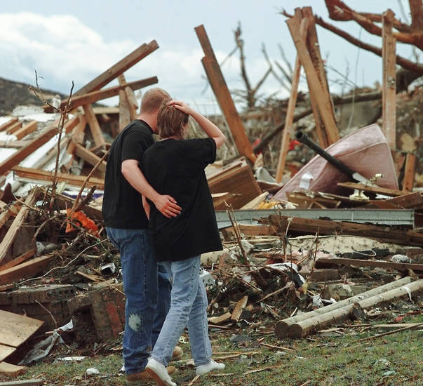 MAY 3, 1999 TORNADO: Tornado victims, damage: Jason Meinhardt comforts his fiance, Melanie Sieger, as they view a destroyed home across from Sieger's home near SE 41 and Angela in Del City.