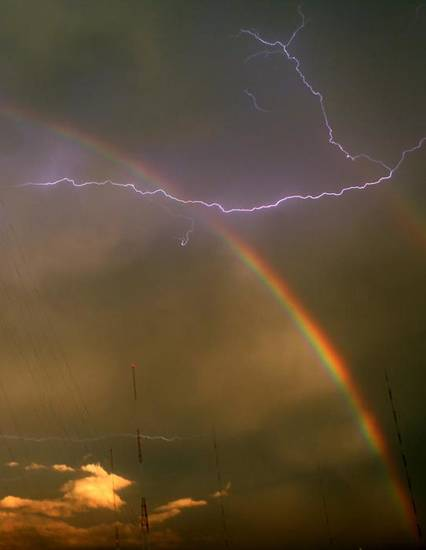 Lightning cracks near a rainbow that stretches over the Northeast side of Oklahoma City on Thursday, September 2, 2010. Photo by John Clanton, The Oklahoman