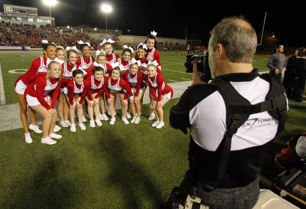 Carl Albert cheerleaders pose for a photograph before their Titans play the Del City Eagles in Class 5A first round playoffs high school football on Friday, Nov. 9, 2012 in Del City, Okla.   Photo by Steve Sisney, The Oklahoman