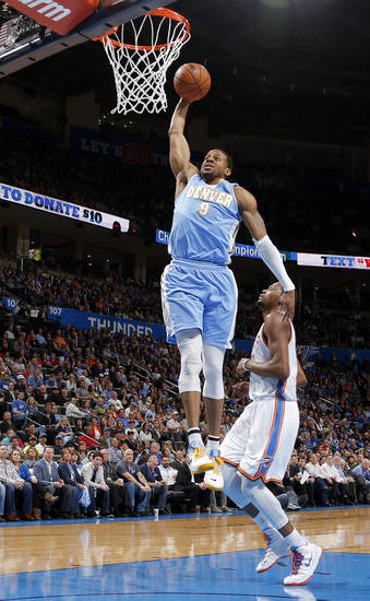 Denver's Andre Iguodala (9) goes to the basket past Oklahoma City's Kevin Durant (35) during an NBA basketball game between the Oklahoma City Thunder and the Denver Nuggets at Chesapeake Energy Arena in Oklahoma City, Tuesday, March 19, 2013. Denver won 114-104. Photo by Bryan Terry, The Oklahoman