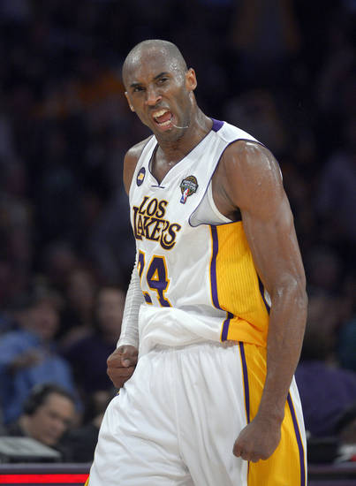 Los Angeles Lakers guard Kobe Bryant celebrates after hitting a three point shot during the second half of their NBA basketball game against the Atlanta Hawks, Sunday, March 3, 2013, in Los Angeles. The Lakers won 99-98. (AP Photo/Mark J. Terrill)  ORG XMIT: LAS120