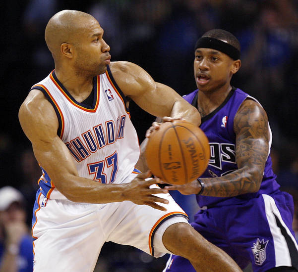 Oklahoma City's Derek Fisher (37) passes away from Sacramento's Isaiah Thomas (22) during the NBA basketball game between the Oklahoma City Thunder and the Sacramento Kings at Chesapeake Energy Arena in Oklahoma City, Friday, April 13, 2012. Oklahoma City won, 115-89. Photo by Nate Billings, The Oklahoman