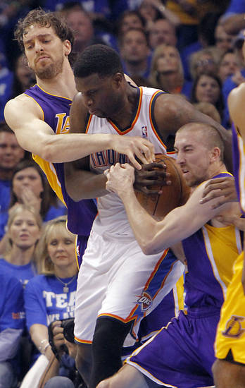 Los Angeles' Pau Gasol and Steve Blake wrap up Oklahoma City's Nazr Mohammed during Game 2 in the second round of the NBA playoffs between the Oklahoma City Thunder and the L.A. Lakers at Chesapeake Energy Arena on Wednesday,  May 16, 2012, in Oklahoma City, Oklahoma. Photo by Chris Landsberger, The Oklahoman