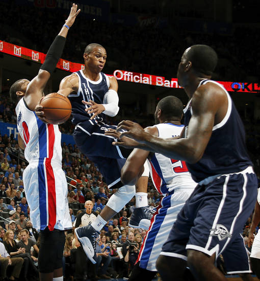 Oklahoma City's Russell Westbrook (0) passes the ball to Kendrick Perkins (5) between Detroit's Greg Monroe (10) and Jason Maxiell (54) during an NBA basketball game between the Detroit Pistons and the Oklahoma City Thunder at the Chesapeake Energy Arena in Oklahoma City, Friday, Nov. 9, 2012. Photo by Nate Billings, The Oklahoman