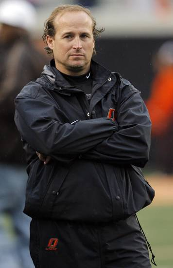 OSU offensive coordinator Dana Holgorsen watches during the Oklahoma State Orange and White spring football game at Boone Pickens Stadium in Stillwater, Okla., Saturday, April 17, 2010. Photo by Nate Billings, The Oklahoman
