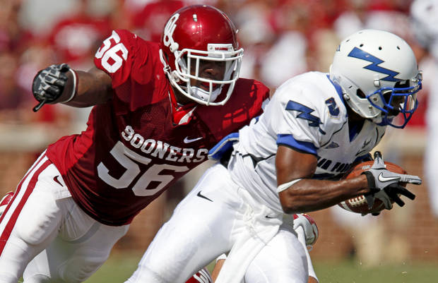 OU's Ronnell Lewis chases down Reggie Rembert of Air Force during the first half of the college football gamebetween the University of Oklahoma Sooners (OU) and Air Force (AF) at the Gaylord Family-Oklahoma Memorial Stadium on Saturday, Sept. 18, 2010, in Norman, Okla.   Photo by Bryan Terry, The Oklahoman