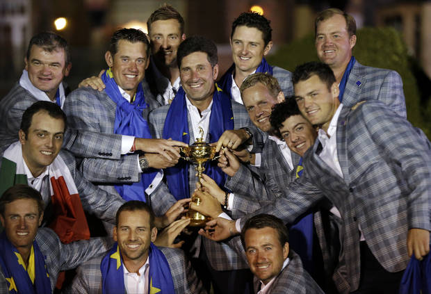 The European team posses with the trophy after winning the Ryder Cup PGA golf tournament Sunday, Sept. 30, 2012, at the Medinah Country Club in Medinah, Ill. (AP Photo/David J. Phillip)  ORG XMIT: PGA268