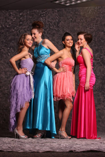 Models Ashlin Weaver, Addison Sneed, Corde Cumba and Keely Hanson pose in promwear. Photo by Steve Webb, for The Oklahoman.   <strong></strong>