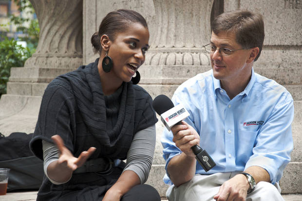 In this Sept. 27, 2012 photo provided by Jackson Hewitt Tax Service, Mark Steber, right, interviews Justine Watson about the fiscal cliff in Madison Square Park for Jackson Hewitt's Tax Bites video series, in New York. (AP Photo/Jackson Hewitt Tax Service)