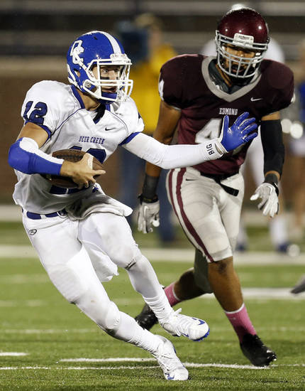 Deer Creek quarterback Joel Blumenthal (12) carries the ball past Edmond Memorial's Kourtney Williams (44) during a high school football game between Edmond Memorial and Deer Creek at Wantland Stadium in Edmond, Okla., Thursday, Sept. 13, 2012. Photo by Nate Billings, The Oklahoman