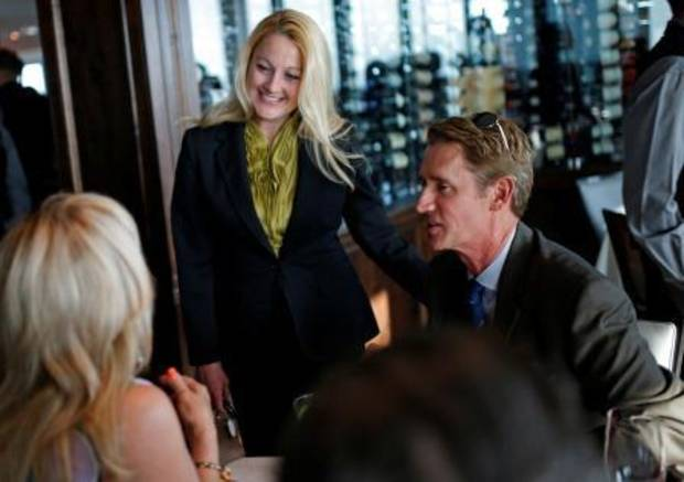 Manager Vivian Wood attends to guests at Wednesday's private preview cocktail party at The George Prime Steakhouse.