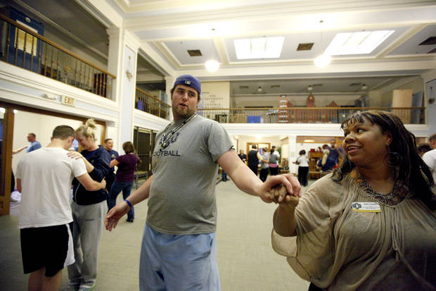 UCO football player Deryck Beveridge and Sherri Forest, of purchasing and payment services, practice for a dancing fundraiser at Evans Hall on the campus of the University of Central Oklahoma in Edmond, Okla., Thursday, Feb. 2, 2012. Photo by Sarah Phipps, The Oklahoman