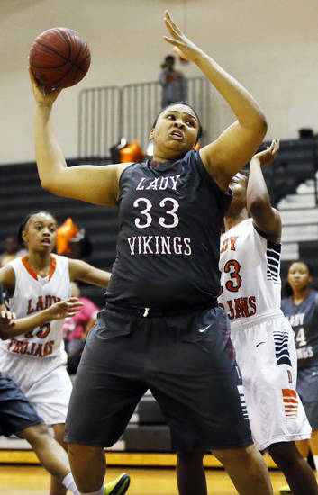 Chanel Akins (33) of Northeast moves to the basket during a girls high school basketball game between Douglass and Northeast at Douglass High School in Oklahoma City, Friday, Feb. 8, 2013. Photo by Nate Billings, The Oklahoman