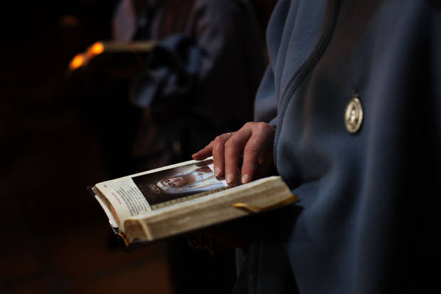 A Catholic nun attends the Washing of the Feet ceremony during the Easter Holy Week, inside the Church of the Holy Sepulchre, traditionally believed to be the burial site of Jesus Christ, in Jerusalem's Old City, Thursday, April 5, 2012. (AP Photo/Bernat Armangue)