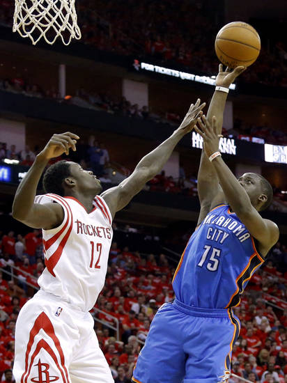 Oklahoma City's Reggie Jackson (15) shoots over Houston's Patrick Beverley during Game 6 in the first round of the NBA playoffs between the Oklahoma City Thunder and the Houston Rockets at the Toyota Center in Houston, Texas, Friday, May 3, 2013. Photo by Bryan Terry, The Oklahoman
