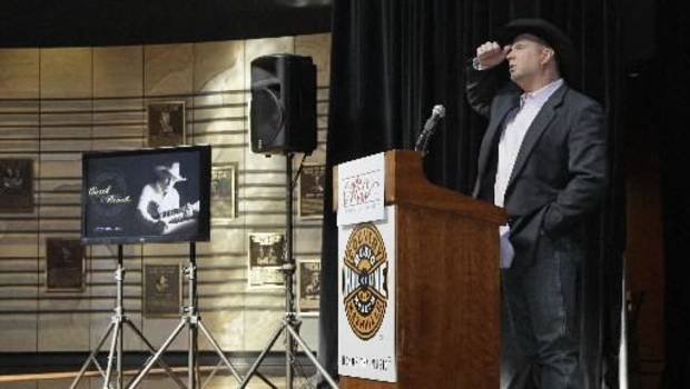"Garth Brooks talks about his career Tuesday, March 6, 2012, during the announcement that he will be inducted into the Country Music Hall of Fame in Nashville, Tenn. Brooks, Connie Smith, and Hargus ""Pig"" Robbins will become the newest members. The announcement was held in the Hall of Fame. (AP Photo/Mark Humphrey)"