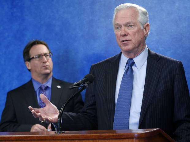 Roy Williams, president and CEO of the Greater Oklahoma City Chamber, gestures as he answers a question at a news conference in Oklahoma City, Wednesday, Feb. 13, 2013. At left is Mike Neal, president and CEO of the Tulsa Regional Chamber. (AP Photo/Sue Ogrocki) ORG XMIT: OKSO102