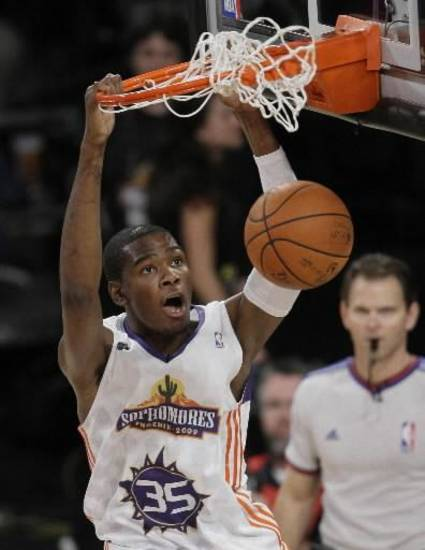 Oklahoma City Thunder sophomore guard  Kevin  Durant (35) dunks against the rookie squad during the first half of the NBA All-Star Rookie Challenge basketball game, Friday, Feb. 13, 2009, in Phoenix. (AP Photo/Matt Slocum)